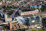 Nederland, Zuid-Holland, Leiden, 15-07-2012; stationsgebied station Leiden centraal, binnenstad in de achtergrond...Railway station district of Leiden and old town in the back..luchtfoto (toeslag), aerial photo (additional fee required).foto/photo Siebe Swart