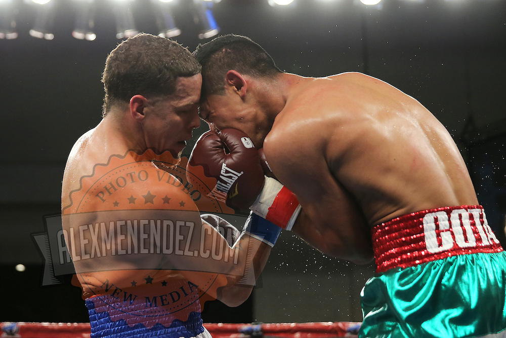 KISSIMMEE, FL - MARCH 06:  Jonathan Oquendo (L) lands a punch to the chest of Gabino Cota as they fight for the WBO Latino Flyweight Title during the Telemundo Boxeo boxing match at the Kissimmee Civic Center on March 6, 2015 in Kissimmee, Florida. Oquendo won the belt after a 10 round unanimous decision on the scorecards. (Photo by Alex Menendez/Getty Images) *** Local Caption *** Jonathan Oquendo; Gabino Cota