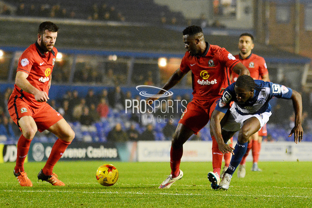 Birmingham City striker Clayton Donaldson is blocked by Blackburn Rovers midfielder Hope Akpan during the Sky Bet Championship match between Birmingham City and Blackburn Rovers at St Andrews, Birmingham, England on 3 November 2015. Photo by Alan Franklin.