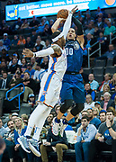 OKLAHOMA CITY, OK - FEBRUARY 26: Orlando Magic Forward Aaron Gordon (00) shooting over Oklahoma City Thunder Forward Carmelo Anthony (7) at Chesapeake Energy Arena Oklahoma City, OK (Photo by Torrey Purvey/Icon Sportswire)