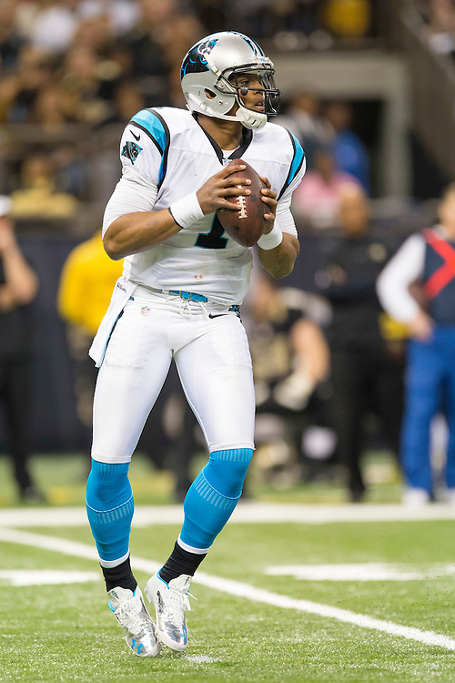 NEW ORLEANS, LA - DECEMBER 30:  Cam Newton #1 of the Carolina Panthers drops back to pass against the New Orleans Saints at Mercedes-Benz Superdome on December 30, 2012 in New Orleans, Louisiana.  The Panthers defeated the Saints 44-38.  (Photo by Wesley Hitt/Getty Images) *** Local Caption *** Cam Newton