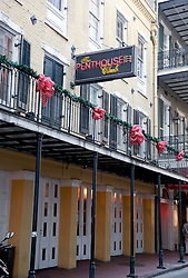 03 January 2014. New Orleans, Louisiana. <br /> The Penhouse club on Bourbon Street in the French Quarter. <br /> Photo; Charlie Varley/varleypix.com