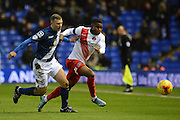 Birmingham City defender Paul Caddis and Charlton Athletic striker Ademola Lookman during the Sky Bet Championship match between Birmingham City and Charlton Athletic at St Andrews, Birmingham, England on 21 November 2015. Photo by Alan Franklin.