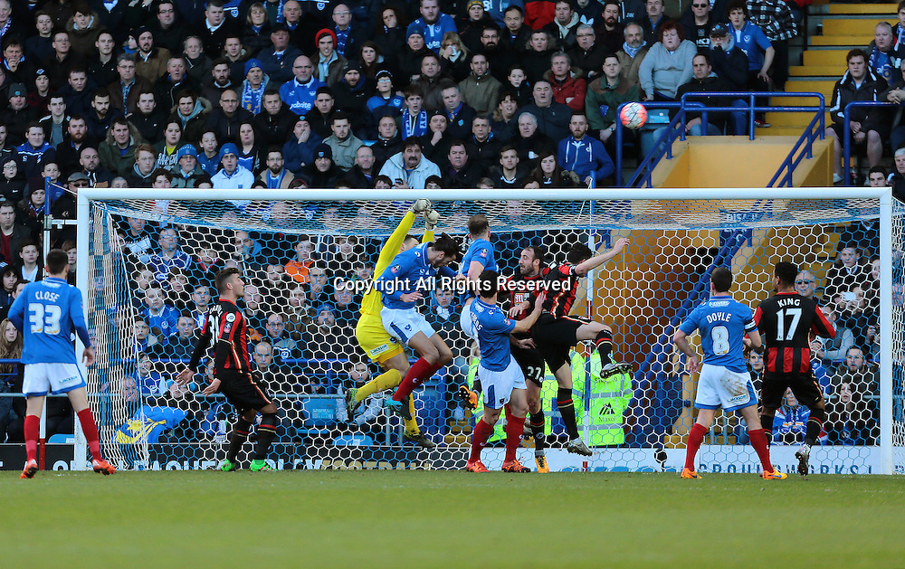 30.01.2016. Fratton Park, Portsmouth, England. Emirates FA Cup 4th Round. Portsmouth versus AFC Bournemouth.  Portsmouth Goalkeeper Ryan Fulton punches a Bournemouth corner clear as Bournemouth Forward Glenn Murray puts in a challenge