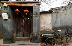 Traditional door to an old courtyard house in a hutong in old district of Beijing, China