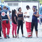 Profughi accolti nel centro polifunzionale 'Teobaldo Fenoglio' di Settimo Torinese, diventato un punto di riferimento per tutto il Paese nel campo dell'accoglienza, delle emergenze, della formazione, delle attività socio-assistenziali.