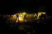 Oregon National Guard soldiers from team 2 lay hose and set up water tanks on their first night out on the Shelton Ridge fire lines.