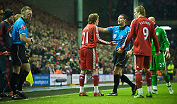 LIVERPOOL, ENGLAND - Saturday, December 26, 2009: Liverpool's Lucas Leiva argues with referee Andre Marriner, who had booked Wolverhampton Wanderers' Christophe Berra instead of Stephen Ward, who had committed the foul leading to Ward's second Yellow Card, and therefore a red during the Premiership match at Anfield. (Photo by: David Rawcliffe/Propaganda)