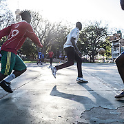 African migrants play football in Yeoville. The football game, taking place after their respective masses and Sunday lunch has become a ritual and a weekly occasion to get together for them. 13 November 2016. Johannesburg, South Africa. © Miora Rajaonary