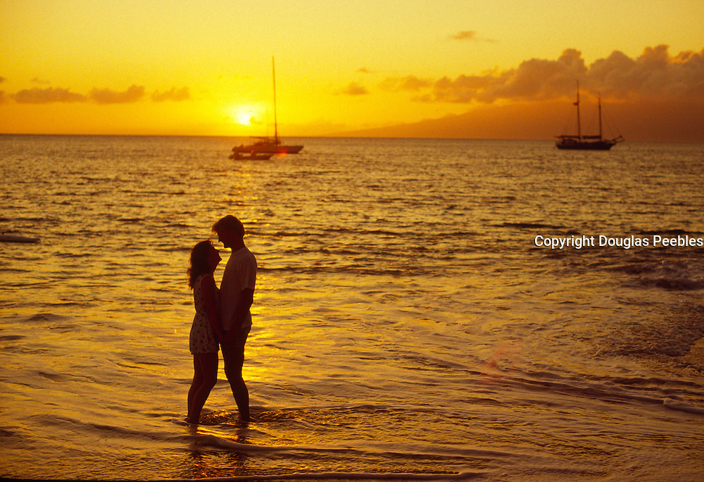 Couple in sunset, Maui, Hawaii<br />