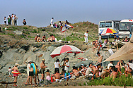 North Koreans enjoy at day Nampho beach,some 50 kilometers south west of Pyongyang, North Korea Sunday Aug. 5, 2007.The leaders of North and South Korea will meet this month for the second time since the peninsula's division after World War II, capitalizing on progress in Pyongyang's nuclear disarmament to revive their historic reconciliation.(AP Photo/Elizabeth Dalziel)