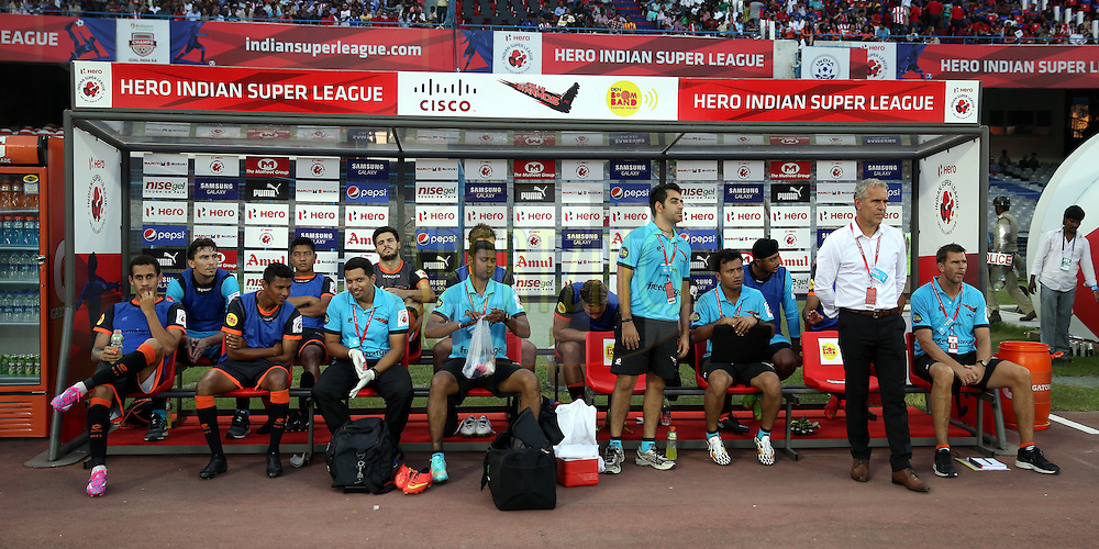 Delhi Dynamos team in dugout during match 7 of the Hero Indian Super League between Atletico de Kolkata and Delhi Dynamos held at the Salt Lake Stadium in Kolkata, West Bengal, India on the 19th October 2014.<br /> <br /> Photo by:  Sandeep Shetty/ ISL/ SPORTZPICS