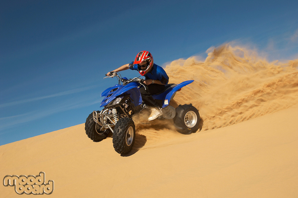 Man riding quad bike in desert