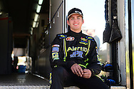 TUCSON, ARIZONA - MAY 07:  Noah Gragson, driver of the #7 Alert I.D./Speed Vegas/Colliers International, sits on on the hauler after practice for the NASCAR K&N Pro Series West NAPA Auto Parts Wildcat 150 at Tucson Speedway on May 7, 2016 in Tucson, Arizona.  (Photo by Jennifer Stewart/NASCAR via Getty Images)
