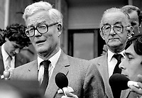 Douglas Hurd, newly appointed Secretary of State for N Ireland, photographed on the occasion of his first Press Conference on the steps of Stormont Castle, Belfast, N Ireland, 27th September 1984, 19840111DH8. Also in the photo (wearing glasses at RHS) is David Gilliland, director of information, N Ireland Office.<br /> <br /> Copyright Image from Victor Patterson, 54 Dorchester Park, Belfast, UK, BT9 6RJ<br /> <br /> t1: +44 28 9066 1296 (from Rep of Ireland 048 9066 1296)<br /> t2: +44 28 9002 2446 (from Rep of Ireland 048 9002 2446)<br /> m: +44 7802 353836<br /> <br /> victorpattersonbelfast@gmail.com<br /> victorpatterson@me.com<br /> <br /> www.victorpatterson.com<br /> <br /> Please see my Terms and Conditions of Use at https://www.victorpatterson.com/page2<br /> It is IMPORTANT that you familiarise yourself with them.<br /> <br /> Images used on the Internet incur an additional cost and must be visibly watermarked i.e. ©Victor Patterson within the body of the image and copyright metadata must not be deleted. Images used on the Internet have a size restriction of 4kbs and are chargeable at rates available at victorpatterson.com.<br /> <br /> This image is available only for the use of the download recipient i.e. television station, newspaper, magazine, book publisher, etc, and must not be passed on to any third party. It is also downloaded on condition that each and every usage is notified within 7 days to victorpatterson@me.com<br /> <br /> The right of Victor Patterson (or the named photographer) to be identified as the author is asserted in accordance with The Copyright Designs And Patents Act (1988). All moral rights are asserted.