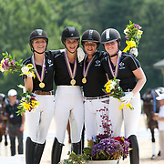 Quebec Gold Medal Junior Dressage Team of Laurence Blais Tetreault, Naima Moreira Laliberte, Frederique Bourgault and Nicole Babich Morin at the 2012 North American Junior and Young Rider Championships in Lexington, Kentucky.