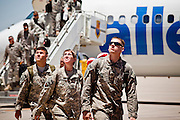 16 JUNE 2010 - PHOENIX, AZ: Spc. Justin Bayles (FRONT) from Phoenix, and other members of his unit walk towards the hangar after disembarking at the 161st Air Refueling Wing hangar at Sky Harbor Airport in Phoenix Wednesday. Members of the 3666th Maintenance Company of the Arizona Army National Guard returned to Phoenix Wednesday after serving in Iraq. PHOTO BY JACK KURTZ