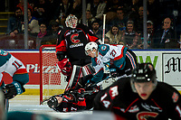 KELOWNA, CANADA - JANUARY 4: Lane Zablocki #27 of the Kelowna Rockets checks Rhett Rhinehart #27 of the Prince George Cougars to the ice during second period on January 4, 2019 at Prospera Place in Kelowna, British Columbia, Canada.  (Photo by Marissa Baecker/Shoot the Breeze)