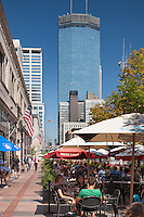 Early Autumn on Nicollet Mall in Minneapolis, Minnesota. Nicollet Mall is traffic restricted in downtown Minneapolis and once was a route of the Streetcars for Minneapolis. Many restaurants are located on Nicollet Mall and the famous Eat Street further south on the Avenue.