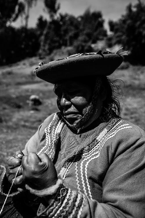 Where: Cuzco, Peru. A local lady spins yarn.
