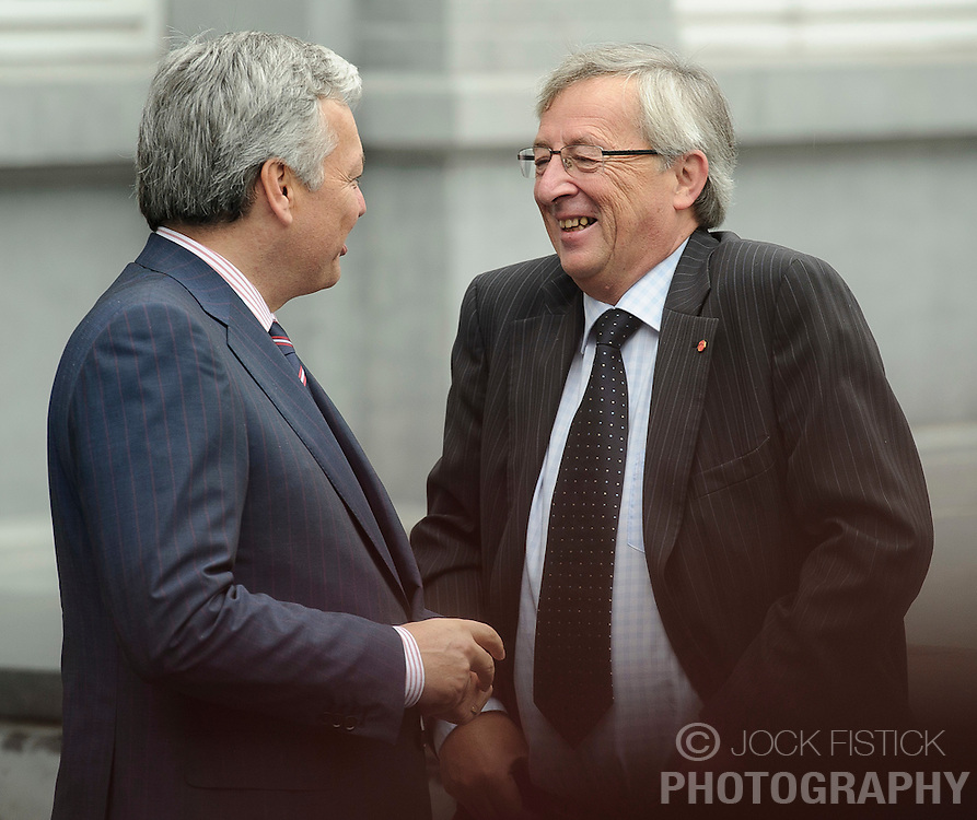 Jean-Claude Juncker, Luxembourg's prime minister, and president of the Eurogroup, right, is greeted by Didier Reynders, Belgium's finance minister, as he arrives for the Eurogroup meeting in Brussels, Thursday Sept. 30, 2010. (Photo © Jock Fistick)