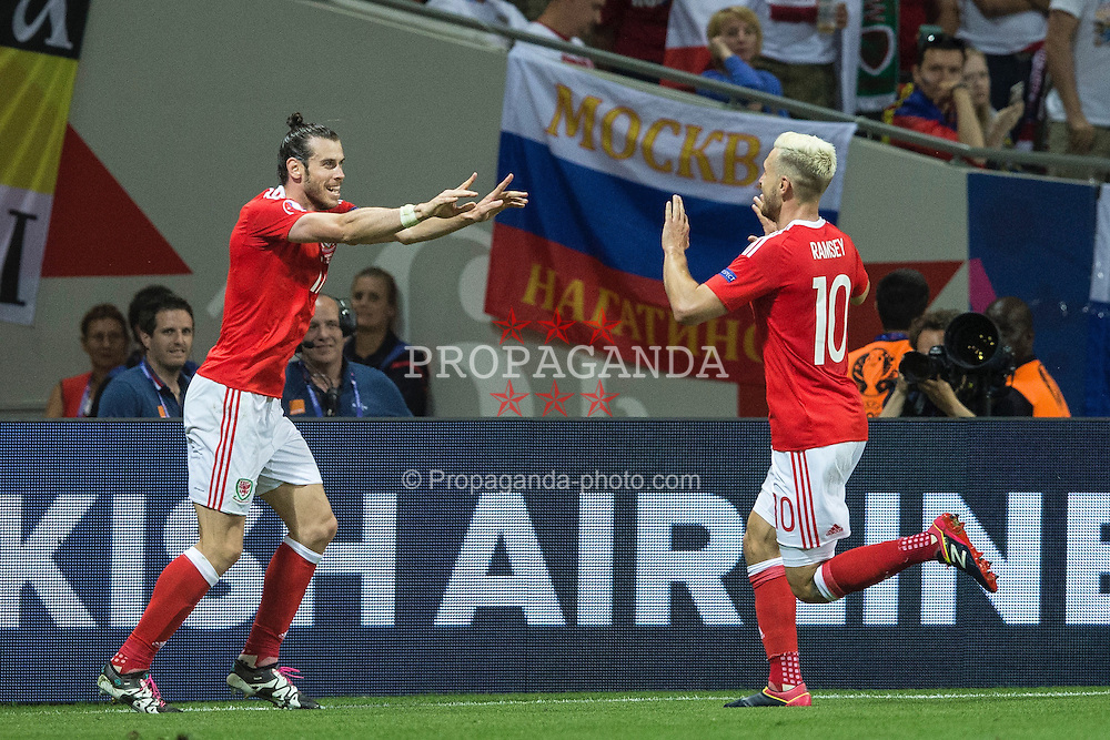 TOULOUSE, FRANCE - Monday, June 20, 2016: Wales' Gareth Bale celebrates scoring the third goal against Russia, with team-mate Aaron Ramsey,  to seal a 3-0 victory during the final Group B UEFA Euro 2016 Championship match at Stadium de Toulouse. (Pic by Paul Greenwood/Propaganda)