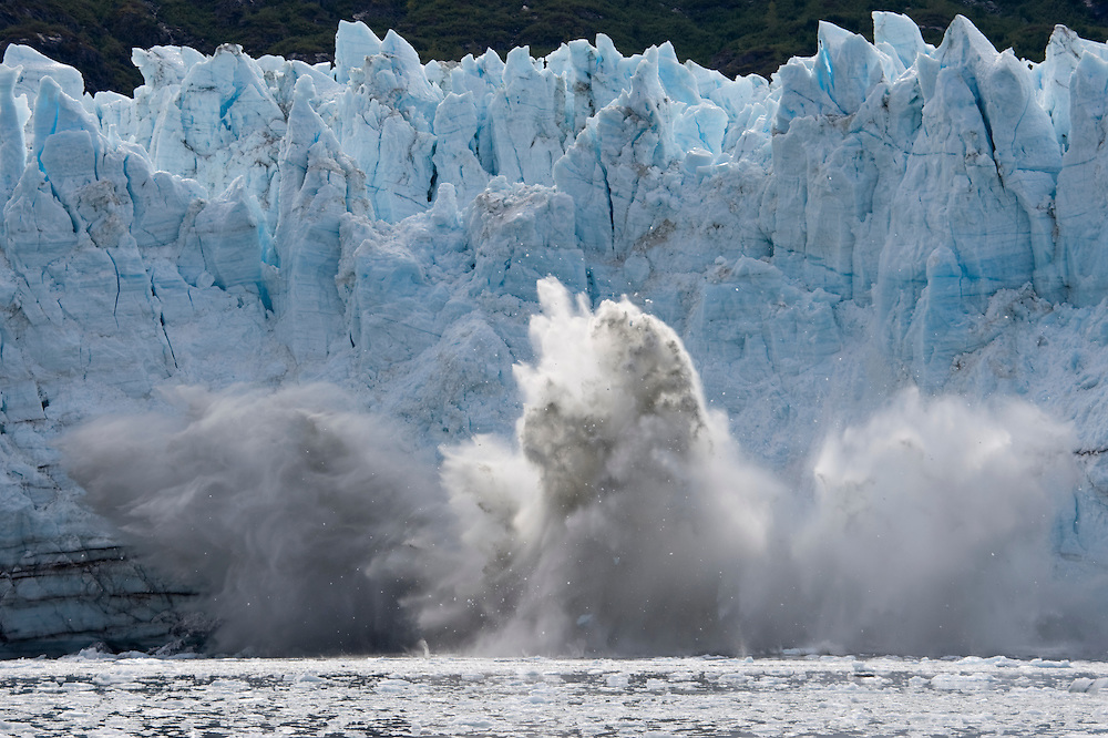 USA, Alaska, Glacier Bay National Park, Icebergs calving from Margerie Glacier along Tarr Inlet on autumn afternoon