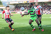 Forest Green Rovers Isaiah Osbourne(34) holds the ball up during the EFL Sky Bet League 2 match between Cheltenham Town and Forest Green Rovers at LCI Rail Stadium, Cheltenham, England on 14 April 2018. Picture by Shane Healey.