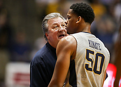 Feb 26, 2018; Morgantown, WV, USA; West Virginia Mountaineers head coach Bob Huggins talks with West Virginia Mountaineers forward Sagaba Konate (50) during the second half against the Texas Tech Red Raiders at WVU Coliseum. Mandatory Credit: Ben Queen-USA TODAY Sports