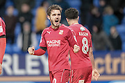 John Goddard (Swindon Town) celebrates the winning goal in front of the Swindon fans, 2-1 to the visitors during the EFL Sky Bet League 1 match between Bolton Wanderers and Swindon Town at the Macron Stadium, Bolton, England on 14 January 2017. Photo by Mark P Doherty.