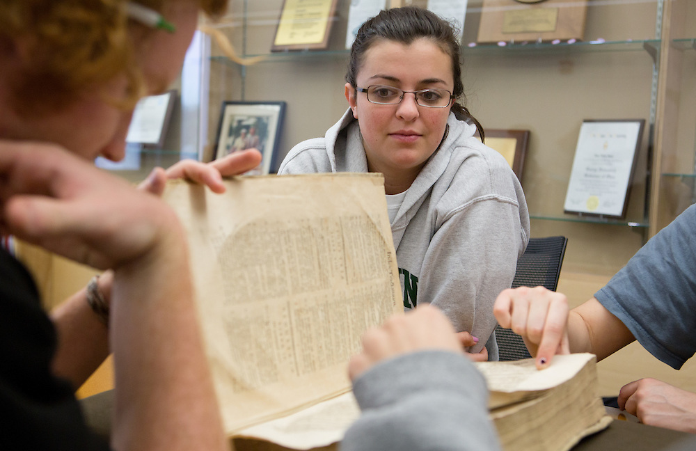 Ohio University student Chloe Farmer examines an ancient math text during a special presentation at Alden Library on April 18, 2014. During the presentation, students enrolled in Associate Professor Bob Klein's History of Mathematics course viewed some of the centuries-old math manuscripts that are stored in the library's Special Collections section. Photo by Lauren Pond