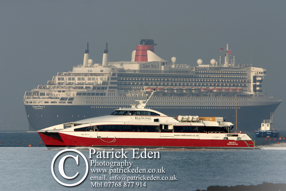 Queen Mary Two. red Jet ferry Photographs of the Isle of Wight by photographer Patrick Eden photography photograph canvas canvases