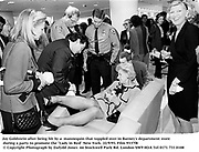"""Joy Goldstein after being hit by a  mannequin that toppled over in Barney's department store during a party to promote the """"Lady in Red"""" New York. 22/9/93. Film 9337f8<br />  © Copyright Photograph by Dafydd Jones<br /> 66 Stockwell Park Rd. London SW9 0DA<br /> Tel 0171 733 0108"""