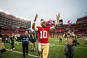 San Francisco 49ers quarterback Jimmy Garoppolo (10) celebrates the San Francisco 49ers win over the Jacksonville Jaguars at Levi's Stadium in Santa Clara, Calif., on December 24, 2017. (Stan Olszewski/Special to S.F. Examiner)