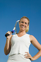 Woman Holding Tennis Racket