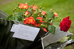 © licensed to London News Pictures. London, UK 24/04/2012. Flowers left for Claire Squires, who collapsed and died in Birdcage Walk, near St James's Park, on the final stretch of the Virgin London Marathon on last Sunday. Photo credit: Tolga Akmen/LNP