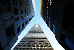 Sunlight reflects on buildings on Merchant Street, close to the Transamerica Prymaid, on Montgomery Street. in San Francisco, CA. Taken on holiday, 2004.©Pic : Michael Schofield.