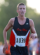 Linn-Mar's Josh Evans (1039) eyes the finish line during the Cedar Rapids Invitational at Noelridge Park in Cedar Rapids on Thursday, September 6, 2012. Evans placed first with a time of 15:32.89.