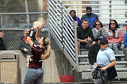 06 April 2013:  Stacia Boeckstiegel goes to the screen to catch a popped up foul while watched by home plate umpire Sally Keller during an NCAA Division 1 Missouri Valley Conference (MVC) women's softball game between the Drake Bulldogs and the Illinois State Redbirds on Marian Kneer Field in Normal IL