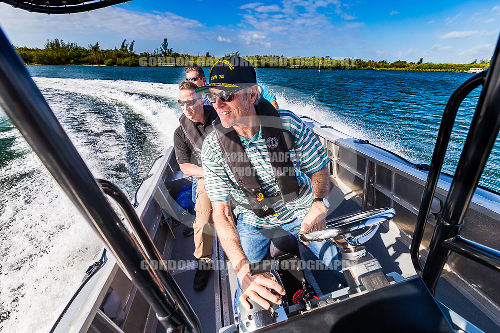 Vice Mayor Mike Oschner test drives a boat on the Indian River.