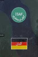 11 AUG 2003, KABUL/AFGANISTAN:<br /> ISAF Logo und Deutsches Nationalitaetskennzeichen mit arabischen Lettern auf einem Fahrzeug des deutschen Kontingents der International Security Assistance Force, ISAF, auf dem militaerischen Teil des Flughafens von Kabul<br /> IMAGE: 20030811-01-005<br /> KEYWORDS: Bundeswehr, Streitkraefte, Streitkräfte,  Logo, Schriftzug, sign