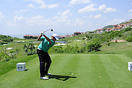Shane Lowry (IRL) tees off the 18th tee during Saturday Morning's Last 16 Group of the 2013 Volvo World Matchplay Championship held  at the Thracian Cliffs Golf & Beach Resort, Kavarna, Bulgaria, 18th May 2013..Picture: Eoin Clarke www.golffile.ie.