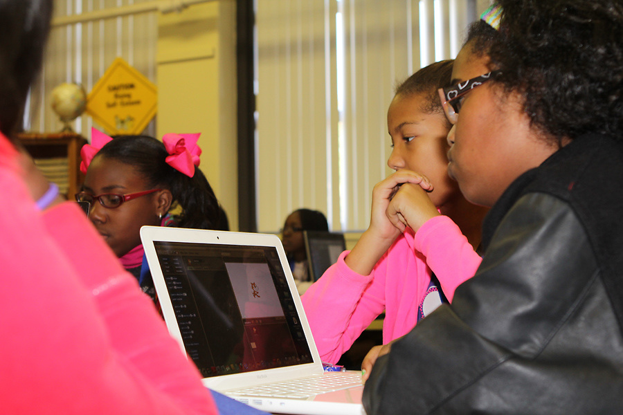 Young Women's College Prep Academy hosted a computer symposium for students, teachers and parents. The Inaugural Schlumberger Log-in Symposium provided participants with free access to computer programming and robotics software, equipment, training, and other resources.  <br />