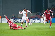 20.11.12. Copenhagen, Denmark.  Luiz Adriano (C) of FC Shakhtar Donetsk fights for the ball with Runje (L) of FC Nordsjaelland during the UEFA Champions League group E stage match. Photo: © Ricardo Ramirez.