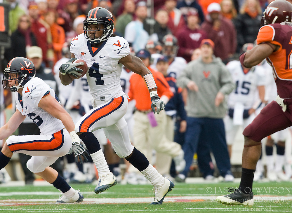 Virginia cornerback Vic Hall (4) rushes for his first of two touchdowns in the first half.  The Virginia Tech Hokies defeated the Virginia Cavaliers 17-14 in NCAA football at Lane Stadium on the campus of Virginia Tech in Blacksburg, VA on November 29, 2008.