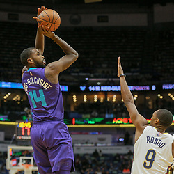 Mar 13, 2018; New Orleans, LA, USA; Charlotte Hornets forward Michael Kidd-Gilchrist (14) shoots over New Orleans Pelicans guard Rajon Rondo (9) during the first quarter of a game at the Smoothie King Center. Mandatory Credit: Derick E. Hingle-USA TODAY Sports