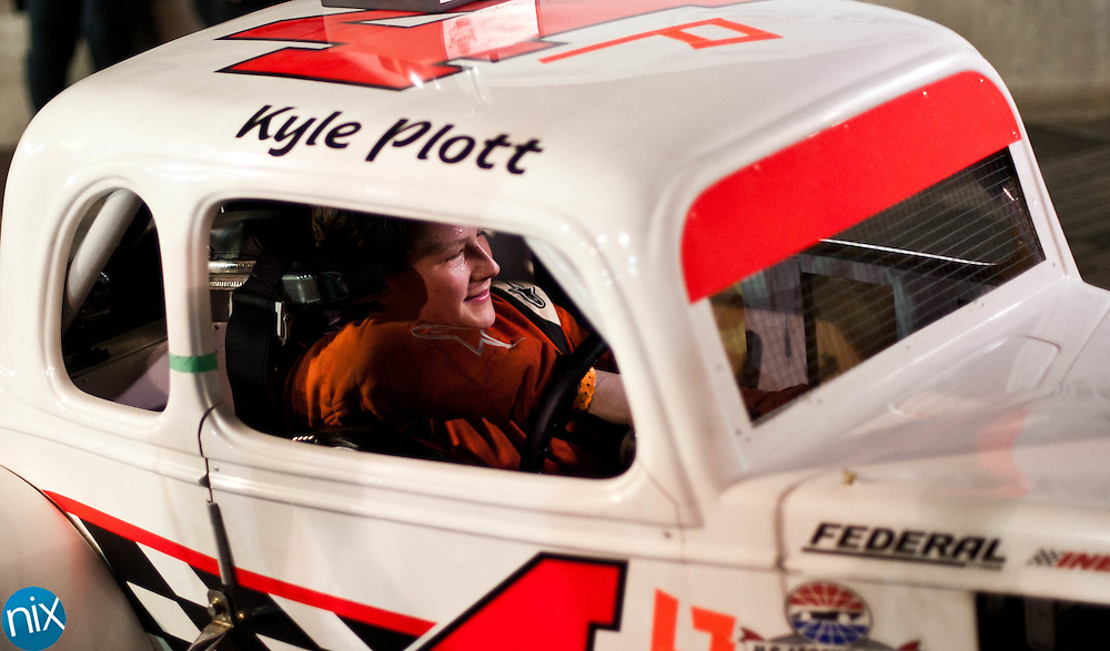Kyle Plott (4P), from Marietta, Ga. waits in his car after winning during the Big Money 100 at Charlotte Motor Speedway Tuesday night. Plott held on Spring Cup drive David Ragan for the win. (photo by James Nix)