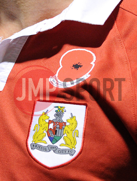 A close up of the Bristol City shirt with the Poppy on - Photo mandatory by-line: Dougie Allward/JMP - Mobile: 07966 386802 - 08/11/2014 - SPORT - Football - Gillingham - Priestfield Stadium - Gillingham v Bristol City - FA Cup - Round One