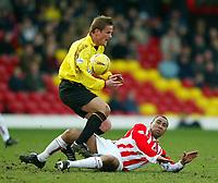 Photo: Scott Heavey.<br />Watford v Sunderland. Nationwide Division One. 07/02/2004.<br />Jeff Whitley slides in on Neal Ardley