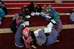 June 14, 2017 - Khan Younis, Gaza Strip - Palestinian girls attend a lesson of Koran, Islam's holiest book on the Muslim holy fasting month of Ramadan, at Hamad Mosque in Khan Younis in the southern Gaza Strip, June 14, 2017. Ramadan is sacred to Muslims because it is during that month that tradition says the Koran was revealed to the Prophet Mohammed. The fast is one of the five main religious obligations under Islam. More than 1.5 billion Muslims around the world will mark the month, during which believers abstain from eating, drinking, smoking and having sex from dawn until sunset  (Credit Image: © Ashraf Amra/APA Images via ZUMA Wire)